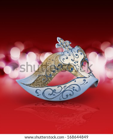 Female carnival mask with glittering background in red mood - stock photo