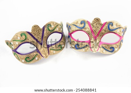 Female carnival masks on white background