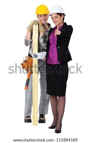Female carpenter and architect - stock photo