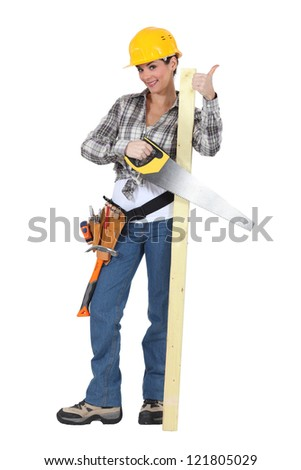 Female carpenter giving thumbs-up