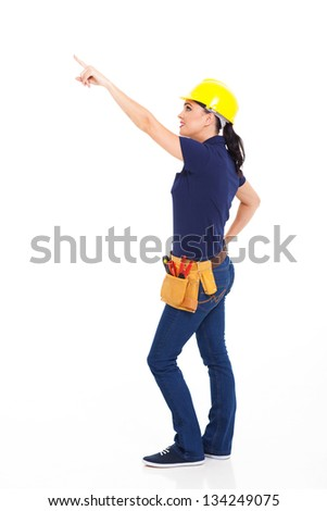 female carpenter pointing at empty copy space