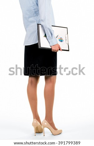 Female carrying clipboard with charts. Woman carrying papers with diagrams. Time to demonstrate monthly report. Market analyst at work. - stock photo