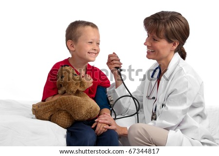Female caucasian doctor giving a cute blond boy a physical, checking his blood pressure, both happy - stock photo