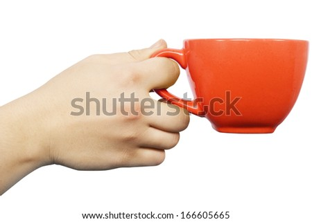 Female Caucasian hand with orange teacup isolated on white background