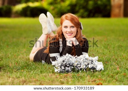 female cheerleader outside - stock photo
