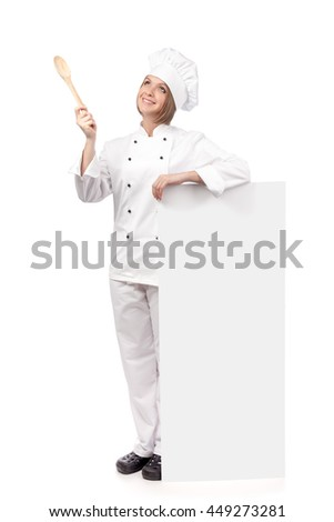 female chef, cook or baker holding spoon and standing next to the banner with empty copy space for you text looking up isolated on white background. advertisement blank board. your text here - stock photo
