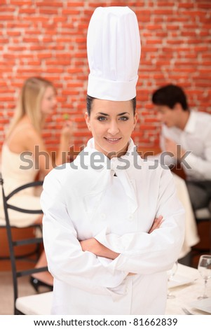 Female chef in full uniform - stock photo