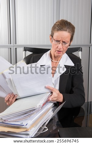 female chef in the office with a lot of papers