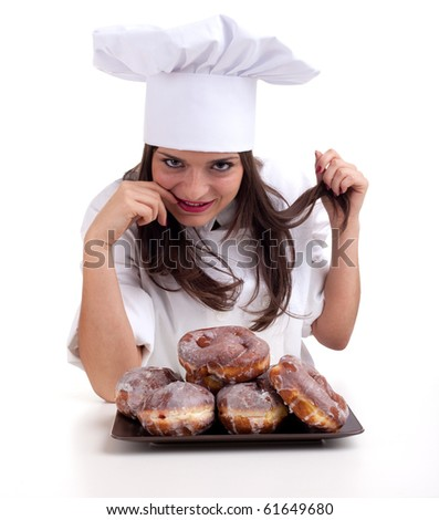 female chef in white uniform and hat with doughnuts