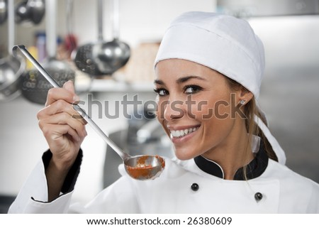 female chef looking at camera and smiling. - stock photo