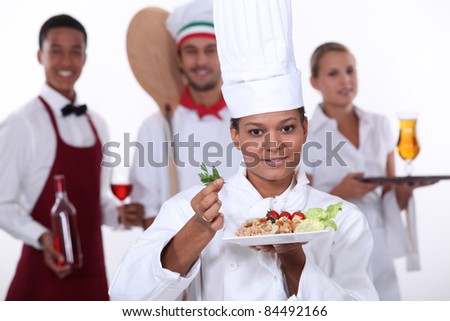 female chef presenting a plate - stock photo