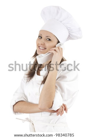 female chef speaking on the phone, white background - stock photo