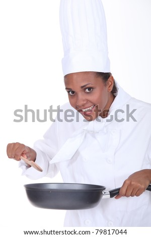 Female chef stirring sauce - stock photo