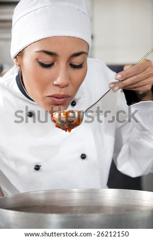 female chef tasting tomato sauce. Copy space - stock photo