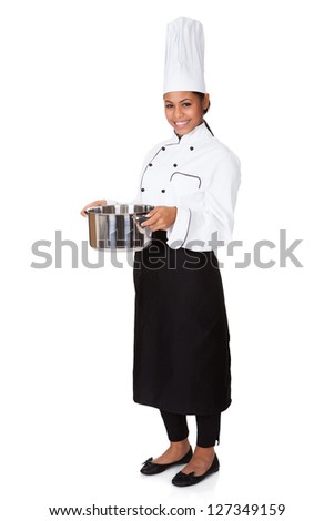 Female Chef With Cooking Pot In Hand. Isolated On White - stock photo