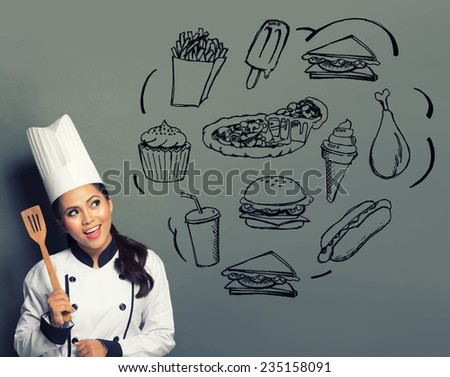 female chef with spatula and thinking what to cook - stock photo