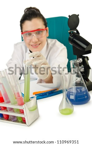 Female chemist in studio on white - stock photo