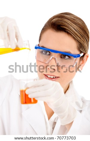 Female chemist using test tubes - isolated over a white background - stock photo