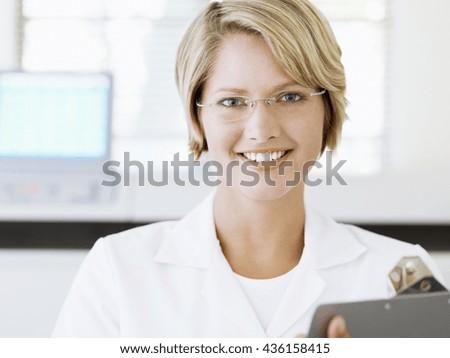 female chemist working in laboratory - stock photo