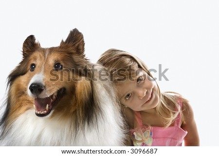 Female child Caucasian with Collie dog.