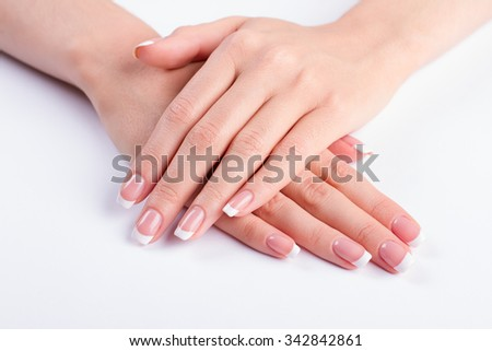 Female classic manicure. Beautiful well-groomed hands.