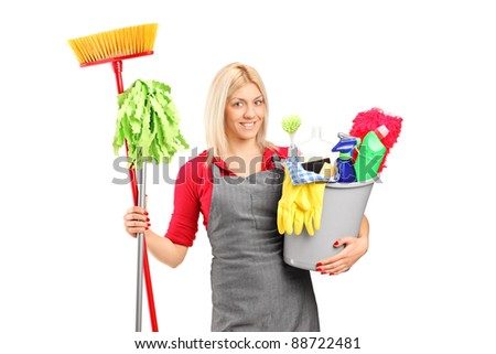 Female cleaner holding a bucket with cleaning supplies isolated on white background - stock photo