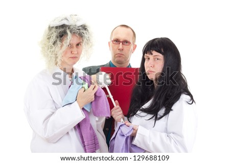 Female cleaners in white work coats with supervisor - stock photo