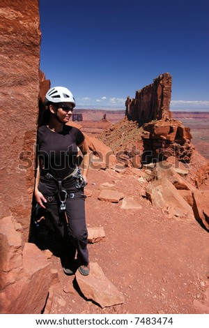 Female climber at the base of Castleton Tower in Utah - stock photo