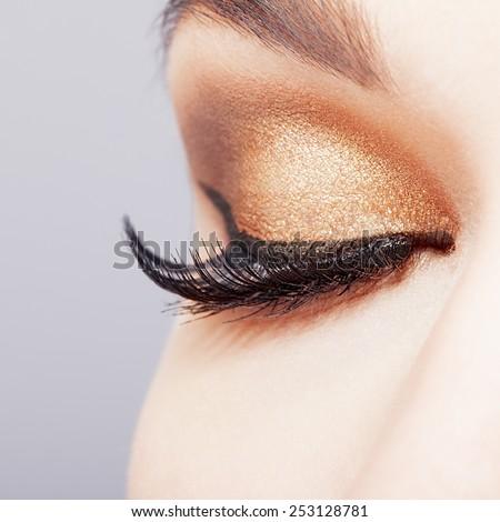 Female closed eye with long eyelashes closeup shot  - stock photo