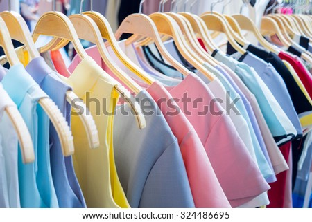 Female cloth hanging on rack