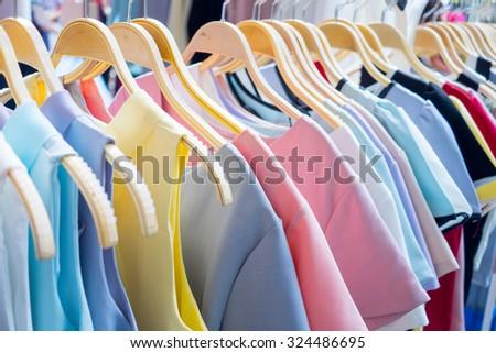 Female cloth hanging on rack - stock photo