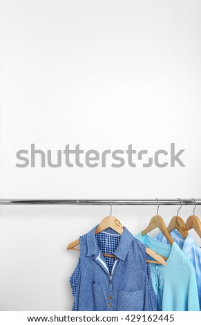 Female clothes hanging in wardrobe - stock photo