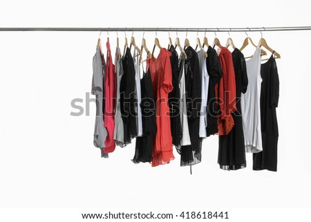 female clothes hanging on clothes rack - stock photo