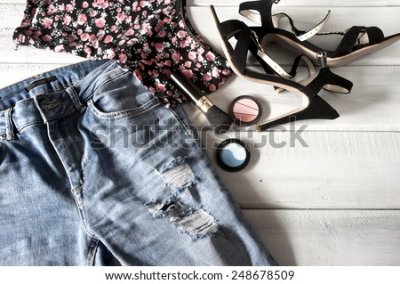 Female clothes, high heels and accessories on floor - stock photo