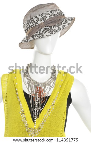 female clothes in scarf with hat on a mannequin