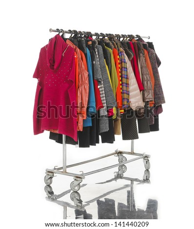 female clothes with coat hanging on clothes rack on white - stock photo