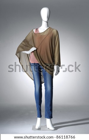 Female clothing in blue jeans mannequin in light background - stock photo