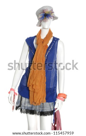 female clothing in hat with scarf, bag on mannequin