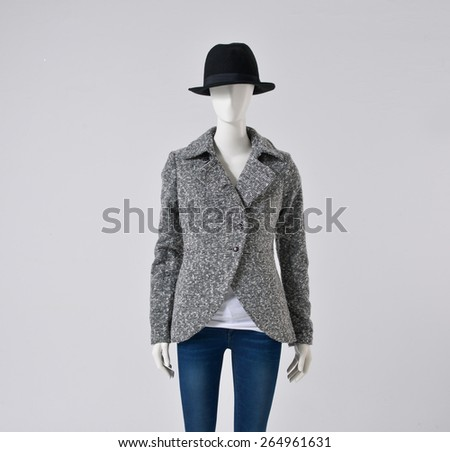 female clothing in jeans ,hat on mannequin  - stock photo