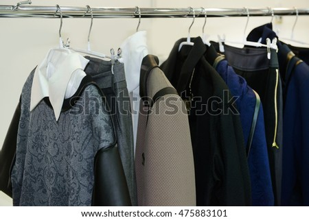 female clothing with set of black coat,jacket on hangers