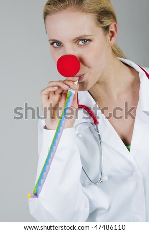 Female clown doctor with red nose