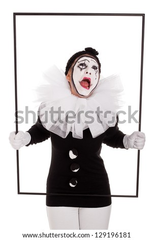 female clown in a frame is crying - stock photo