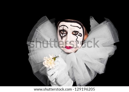 female clown with broken heart - stock photo