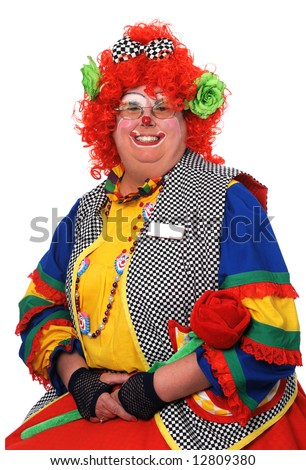Female clown with colorful attire smiling