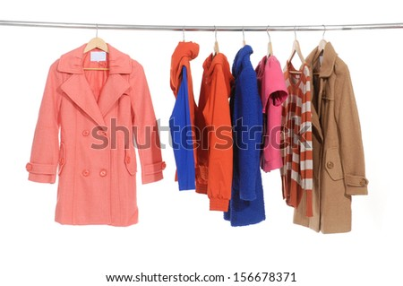 female coat clothing on hangers at the show