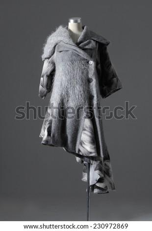 female coat clothing on mannequin isolated - stock photo