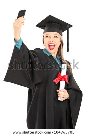 Female college graduate holding a diploma and taking selfie isolated on white background - stock photo