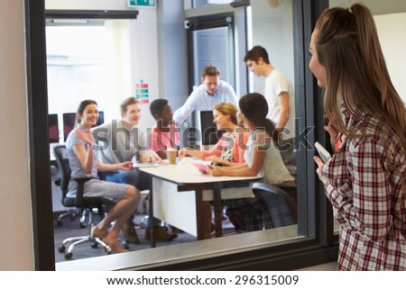 Female College Student Arriving For Tutorial - stock photo
