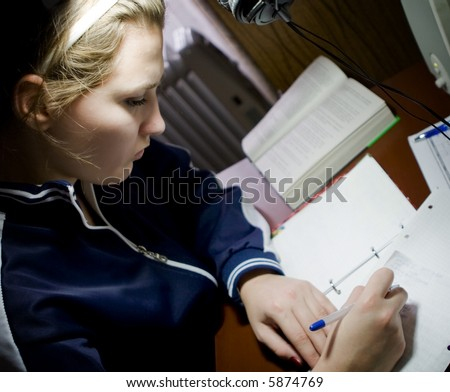Female college student doing her homework - stock photo