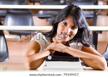 Female college student in university lecture room - stock photo